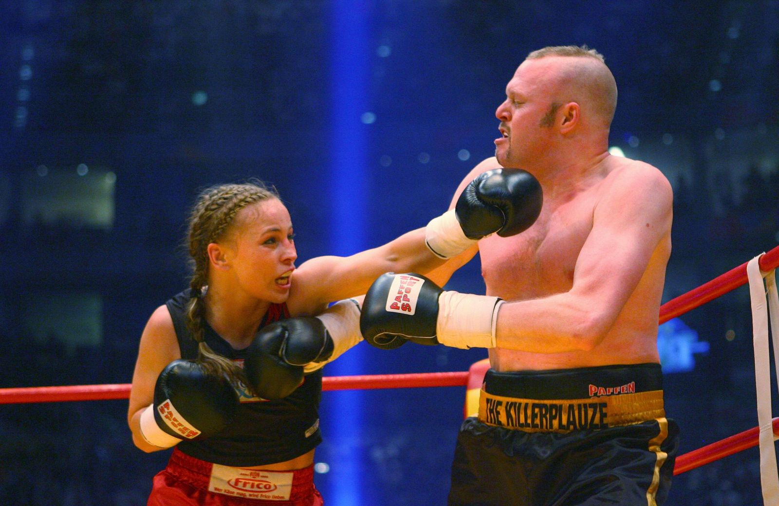 German WIBF flyweight World Champion Halmich punches entertainer Raab during their exhibition boxing fight in Cologne