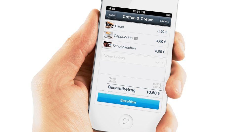 Mobiles Bezahlen: Das Lesegerät wird auf den Kopfhöreranschluss aufgesteckt