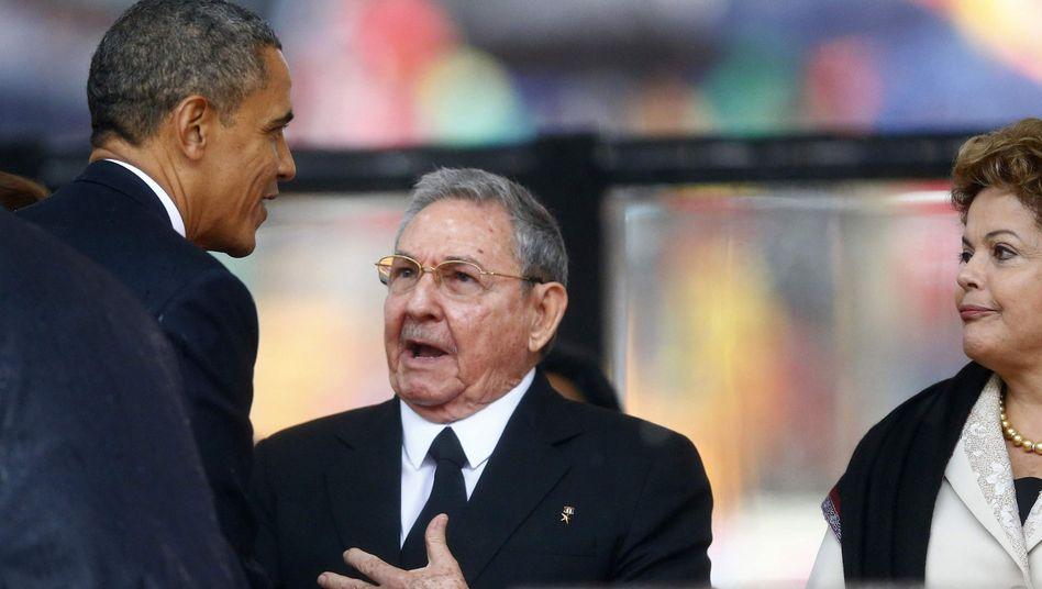US-Präsident Obama (l.), Kubas Castro: Handschlag in Johannesburg