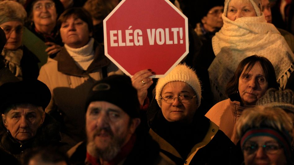 """""""Enough!"""" Hungarians have begun taking to the street to protest far-reaching reforms pushed through be Prime Minister Viktor Orban."""