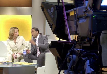 ZDF TV presenter Cherno Jobatay (right) is one of the few immigrant faces of German public television.