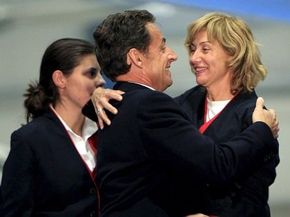 French President Nicolas Sarkozy embraces one of the freed Spanish flight attendants as she disembarks in Madrid.