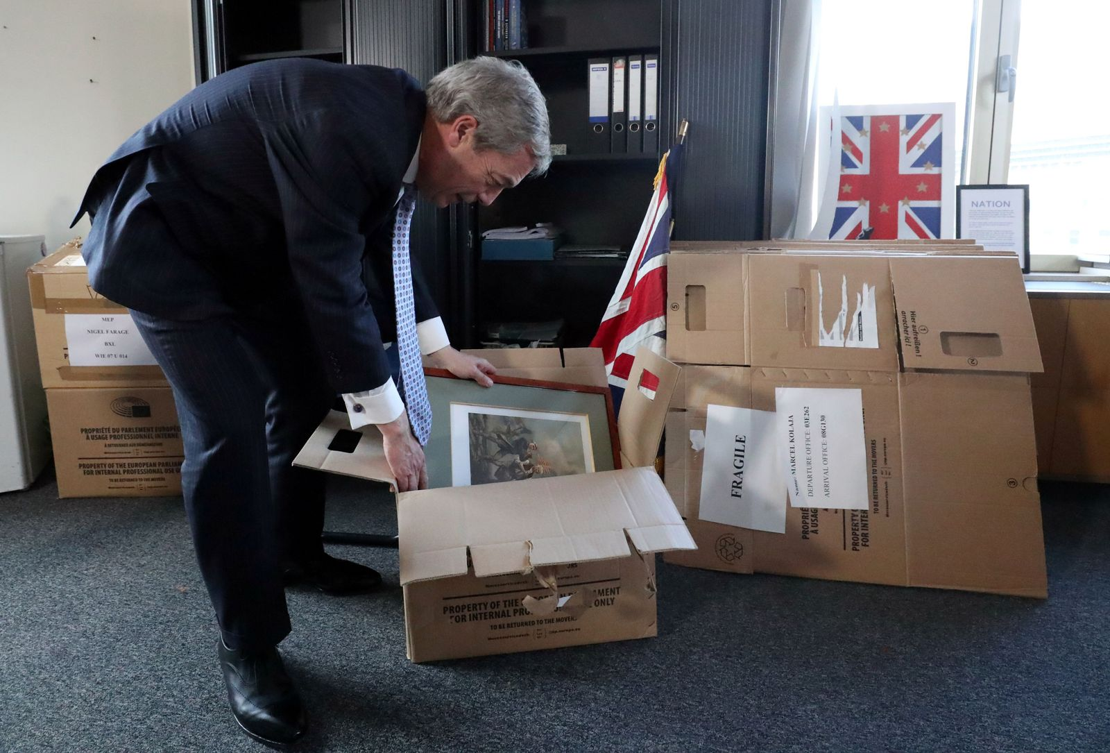 Brexit Party leader Farage packs his items in his office at EU Parliament in Brussels