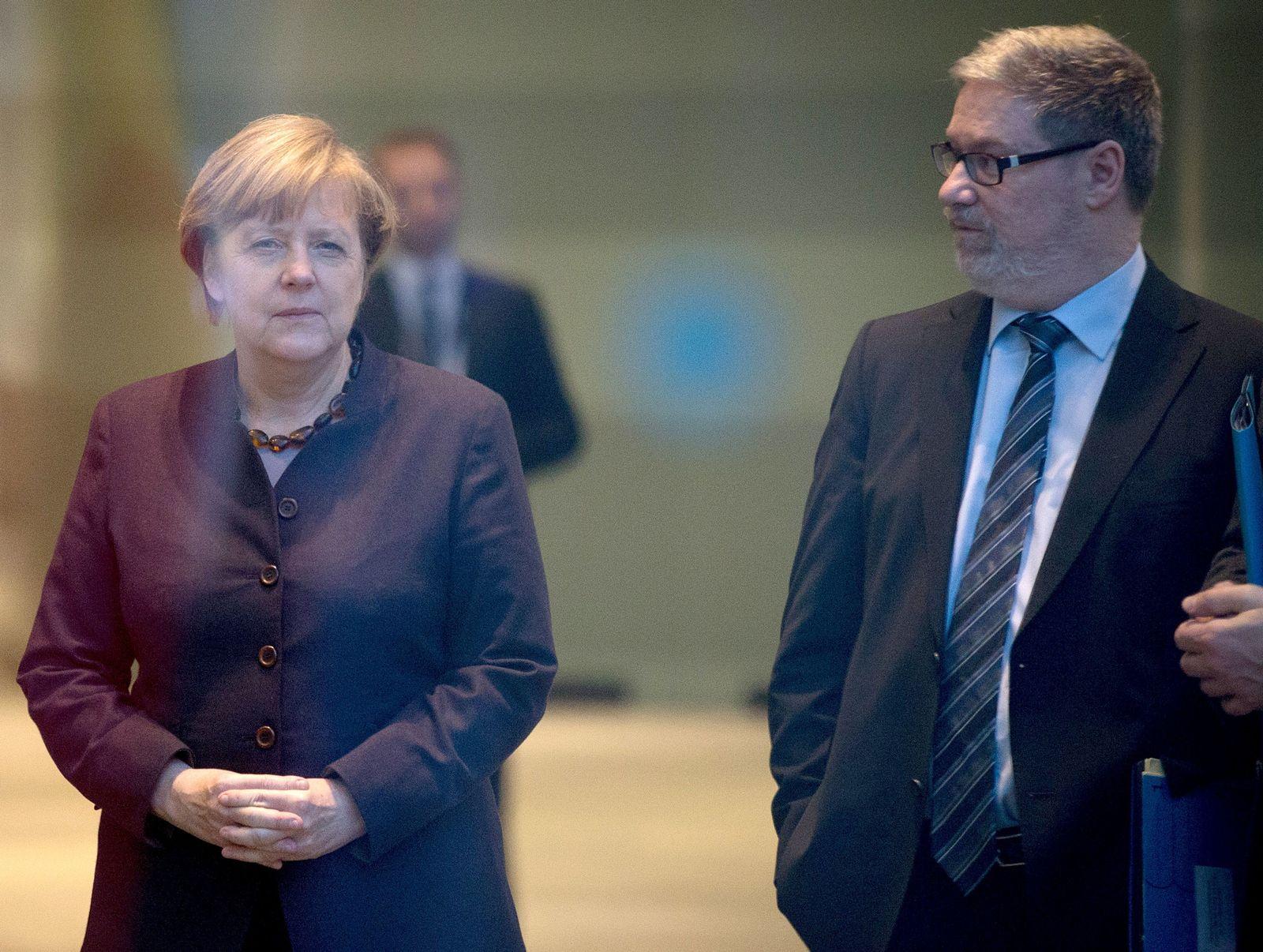 Bundeskanzlerin Merkel und Lars-Hendrik Röller