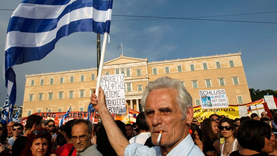 Greeks protest against austerity measures outside the parliament in Athens on June 5.