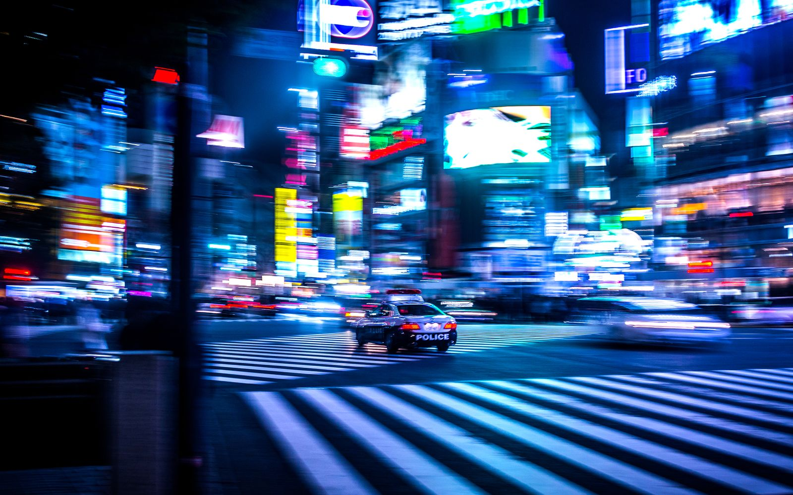 Blurred Motion Of Cars On Road In Illuminated City At Night