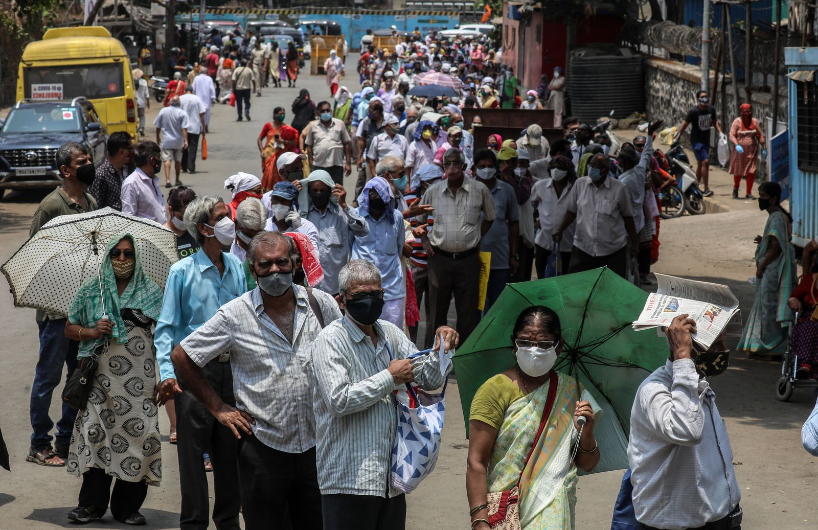 People wait outside vaccination centre in Mumbai