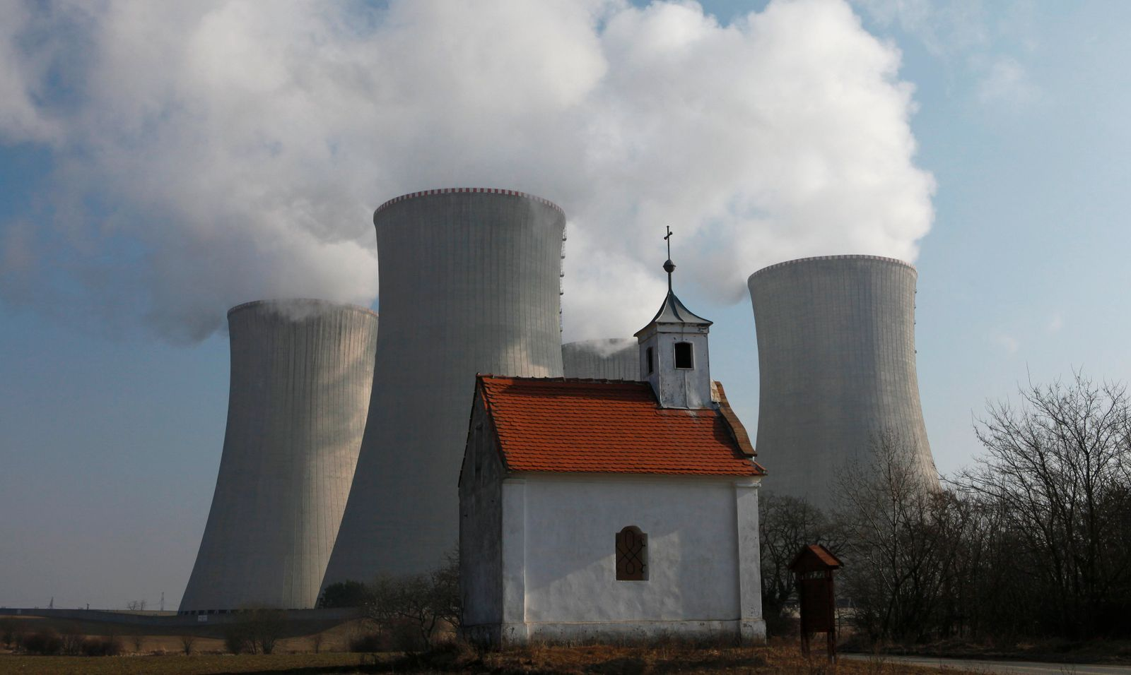 A chapel is seen in front of the cooling towers of the Czech nuclear power plant at Dukovany