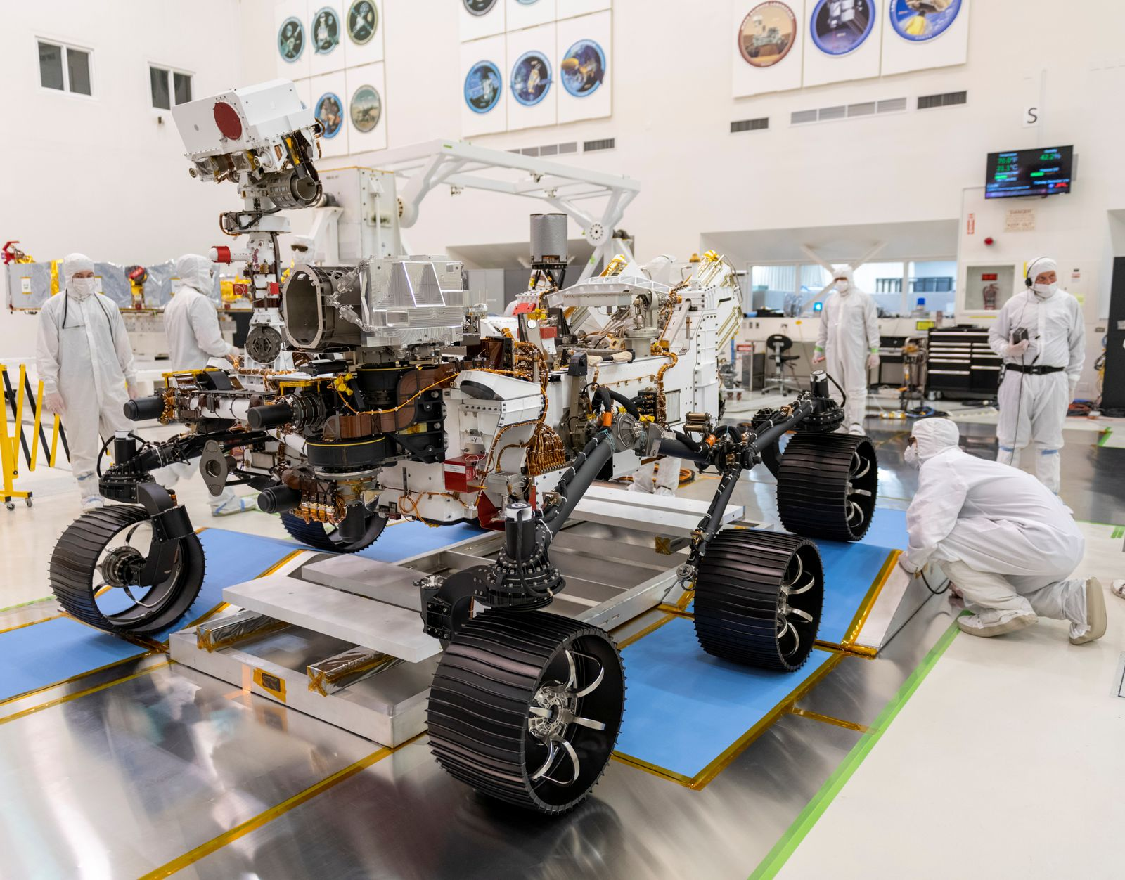 Engineers observe the first driving test for NASA's Perseverance Mars rover in a clean room at Jet Propulsion Laboratory