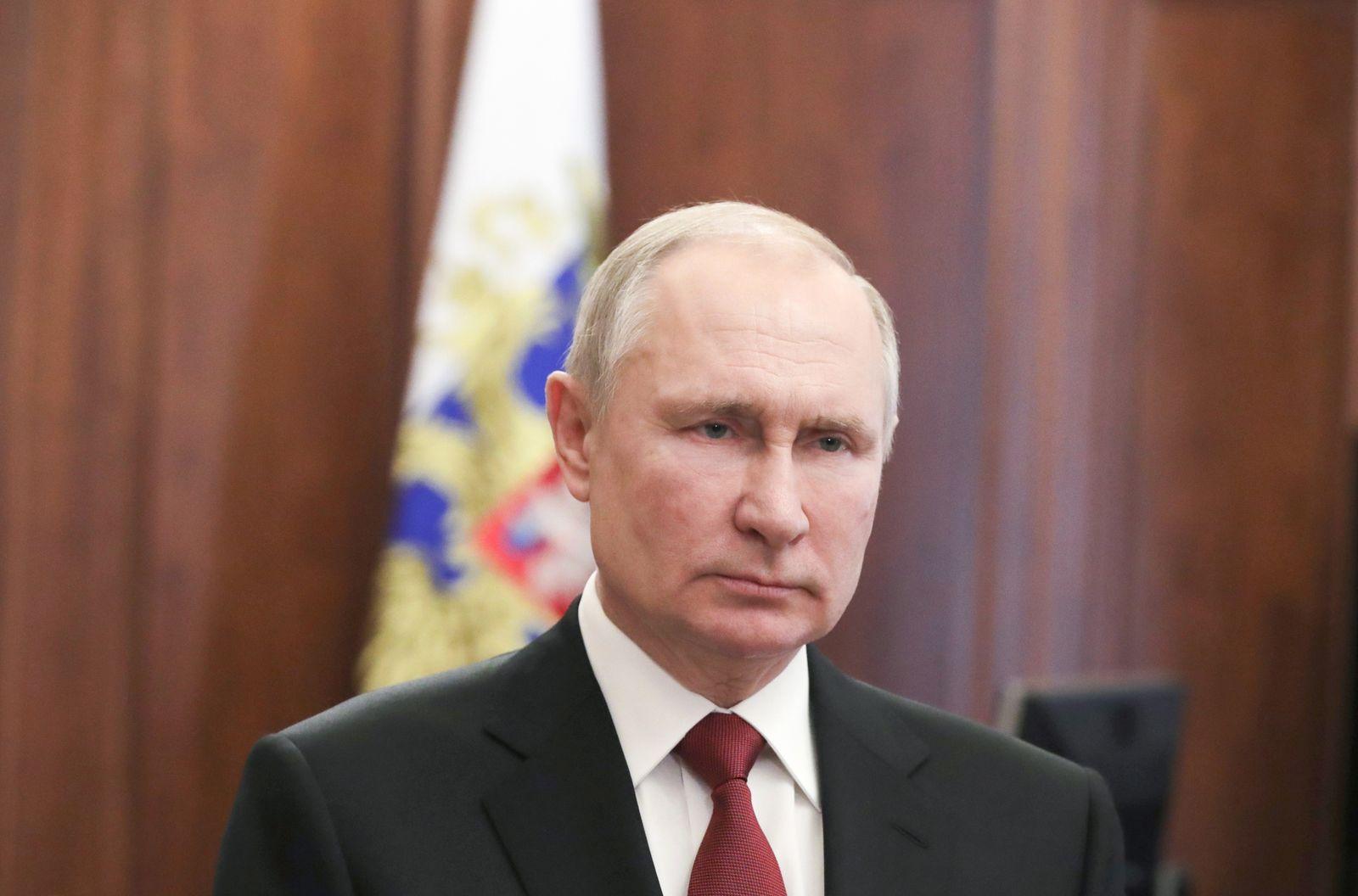 Russian President Vladimir Putin speaks via video on Defender of the Fatherland Day