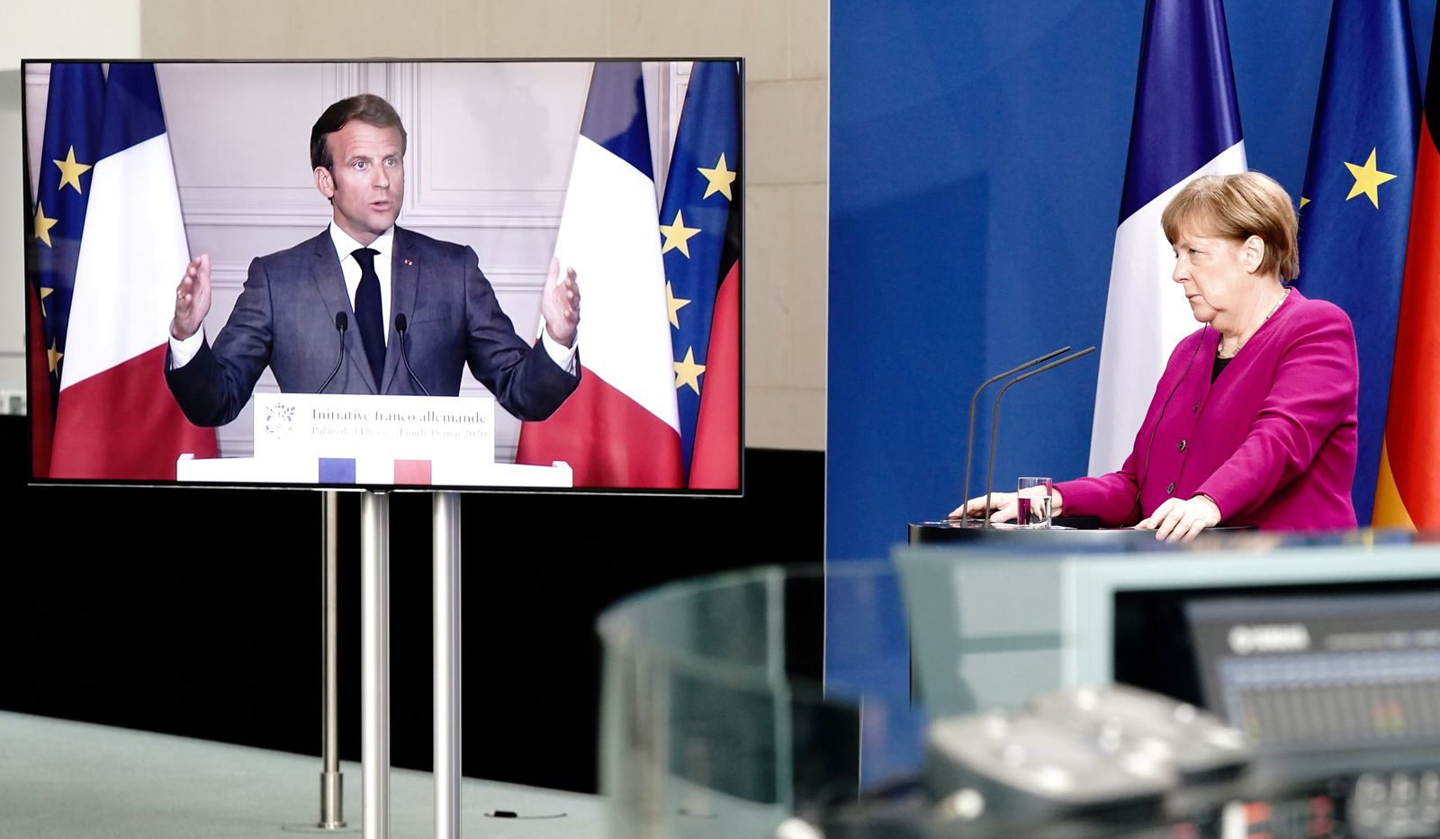 FILE PHOTO: German Chancellor Angela Merkel holds a joint video news conference with French President Emmanuel Macron
