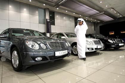 An UAE man inspects new Mercedes Benz cars in Dubai.
