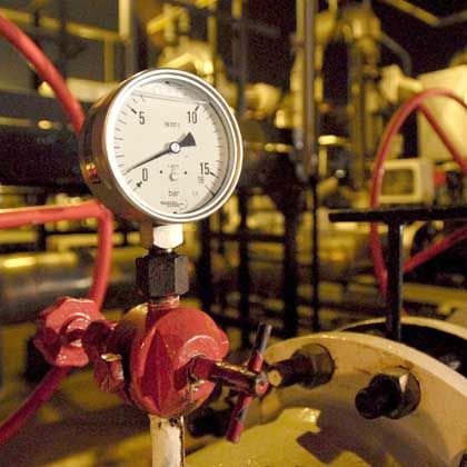 A pipeline pressure gauge shows the halt to Russian oil supplies.