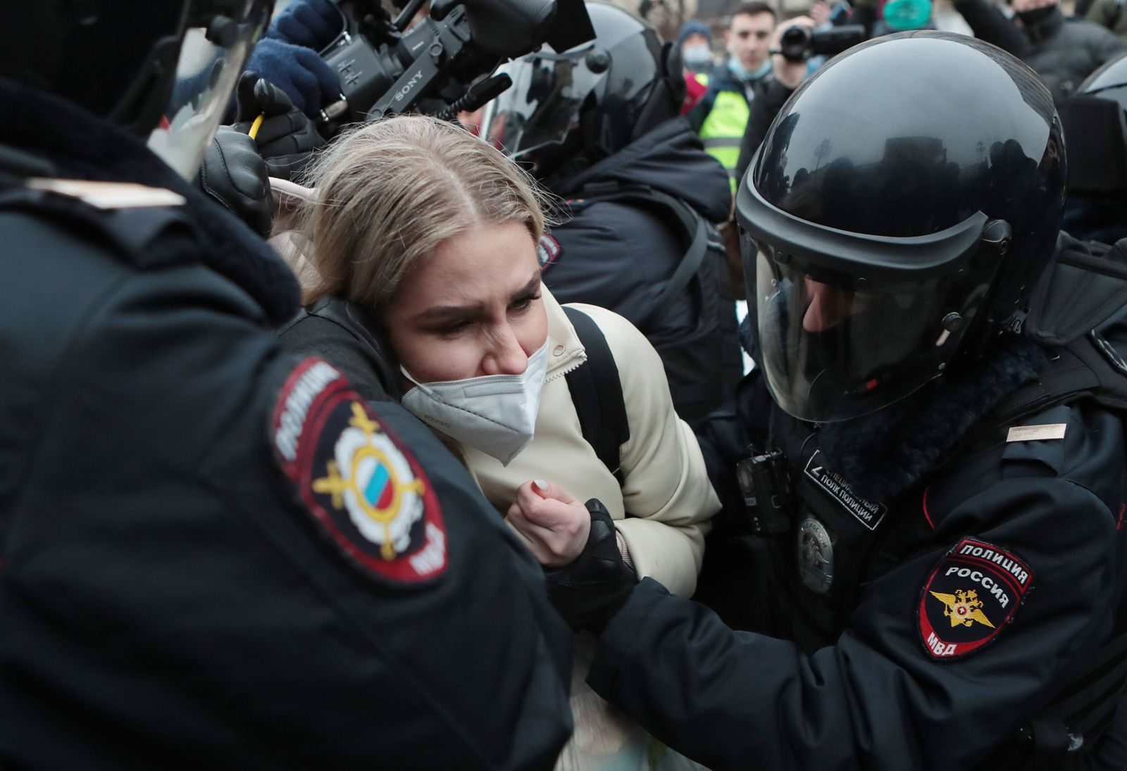 MOSCOW, RUSSIA - JANUARY 23, 2021: Riot police officers detain Lyubov Sobol, a Russian opposition activist, a lawyer at