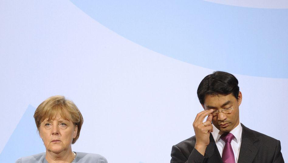 "Kanzlerin Merkel, Vize Rösler: ""Einmaliger Vorgang"""