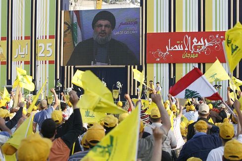 Hezbollah supporters in Beirut listen to a speech given by the movement's leader, Hassan Nasrallah. Hariri's growing popularity could have been a thorn in the side of Lebanese Shiite leader Nasrallah.