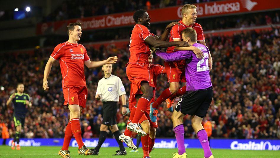Liverpool-Profis Lucas, Touré, Mignolet (v.l.): 14:13-Sieg im Elfmeterschießen