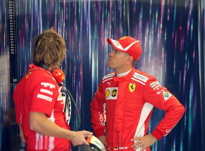 Sebastian Vettel (r.)