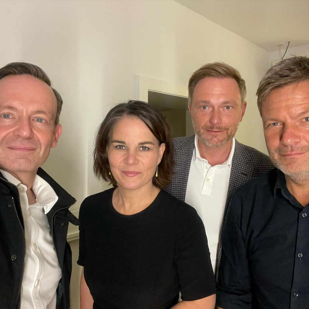 German politicians Volker Wissing and Christian Lindner of the FDP, together with Annalena Baerbock and Robert Habeck of the Greens, pose for a selfie photograph, in this picture obtained from social media