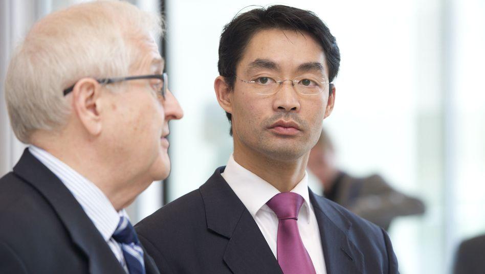 FDP-Politiker Rösler (r.), Brüderle: Ende der Personalstreitigkeiten