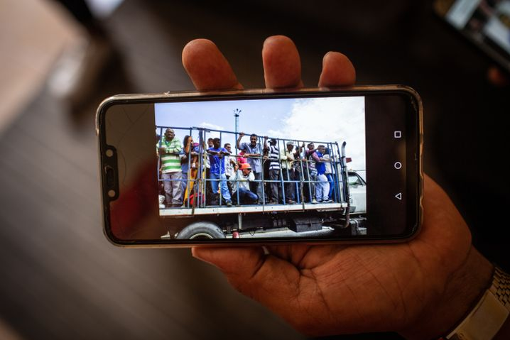 Zuleta, a former public transportation unionist, shows a photo of Venezuela's collapsed public transport system.