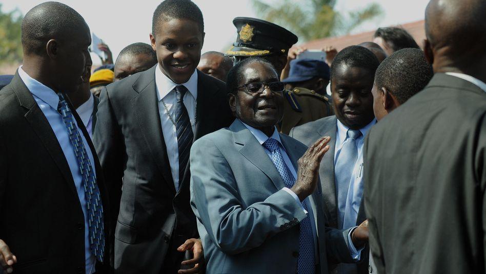 """Simbabwes Präsident Mugabe nach der Stimmabgabe: """"Wir haben überzeugend gewonnen"""""""