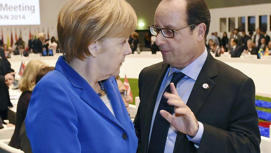 Kanzlerin Merkel und Präsident Hollande (Archivbild): Friedensplan orientiert sich am Minsker Abkommen