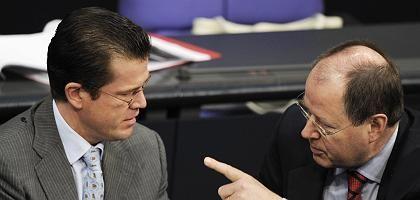 CSU-Minister Guttenberg, Finanzminister Steinbrück: Kollegiale Gegner