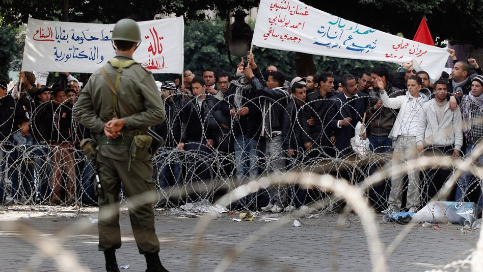 Protesters outside the Interior Ministry in Tunis on Monday