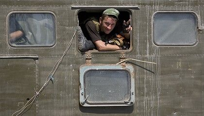 A Russian soldier in a troop carrier departing the Georgian city of Gori on Friday.
