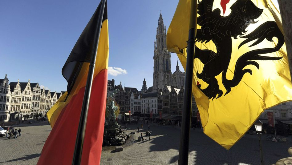 The Belgian and Flemish flags in the main square in Antwerp. Whither Belgium.