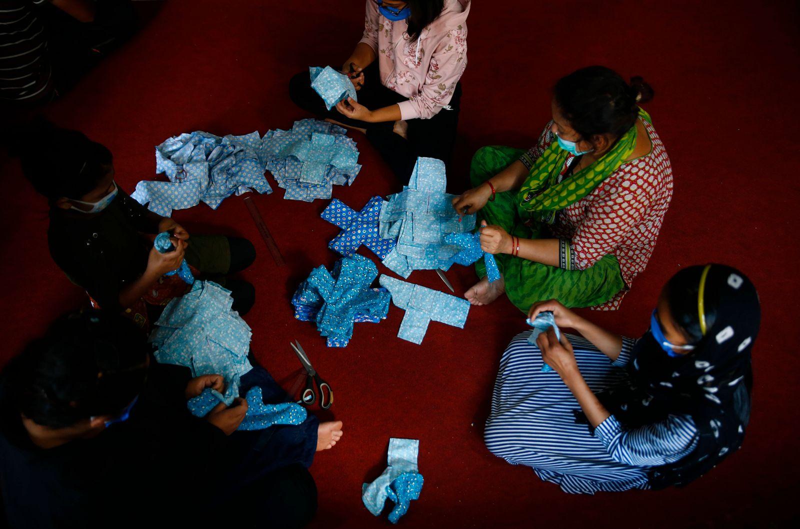 June 6, 2020, Kathmandu, Nepal: Volunteers of Mirmirey Youth Society make reusable sanitary pads at Sinamangal in Kathma