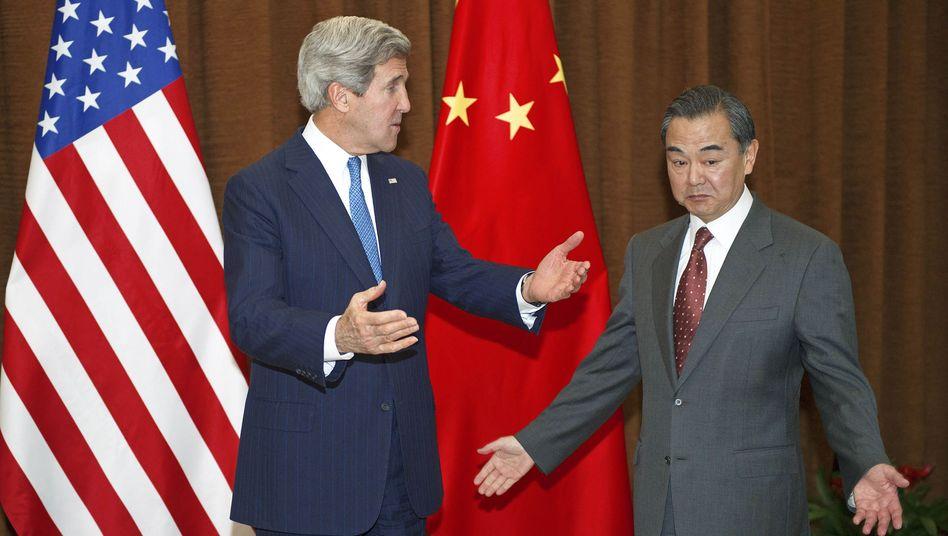 Außenminister John Kerry (links) und Wang Yi: Gemeinsam gegen das Böse im Netz