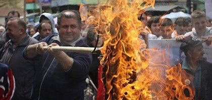 Protesters set fire to the replica of a judge's robe during a protest over the acquittal of Ramush Haradinaj, a former Kosovo prime minister who had been tried for war crimes in The Hague. In other parts of Kosovo, he was celebrated.