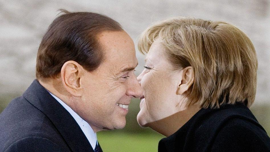 Premier Berlusconi, Kanzlerin Merkel: Kuckuck hinter der Säule
