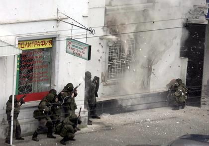 In the southern city of Nalchik on Friday, Russian special armed forces storm a shop defended by rebel gunmen.