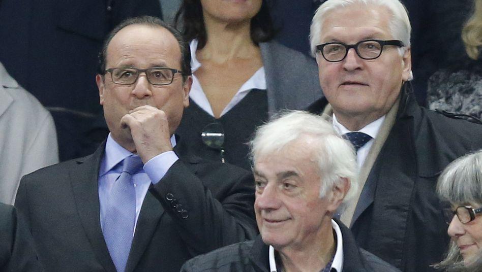 Hollande (l.) und Steinmeier im Stadion: Jedes beunruhigende Signal vermieden