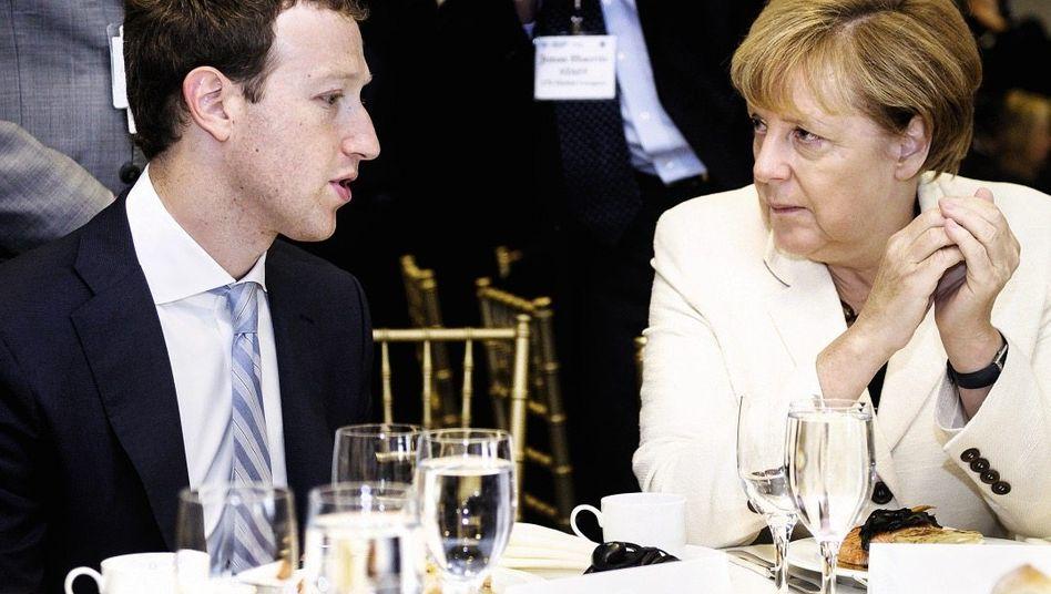 Gesprächspartner Zuckerberg, Merkel(*): Fenster zur Welt