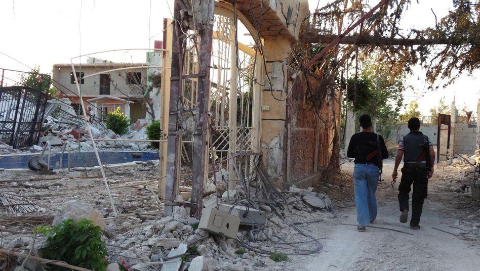 Zerstörte Häuser in Mleiha: Die Stadt wird fast täglich bombardiert