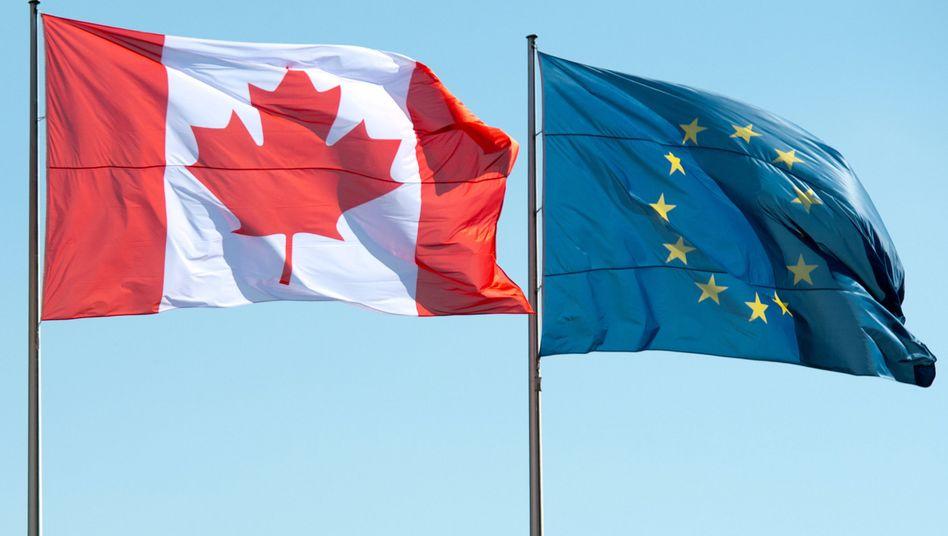 Flaggen Kanadas und der EU