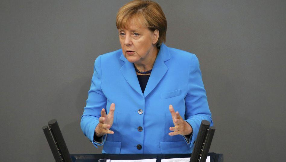 Merkel im Bundestag: Deutschland soll in Flüchtlingsfrage vorangehen