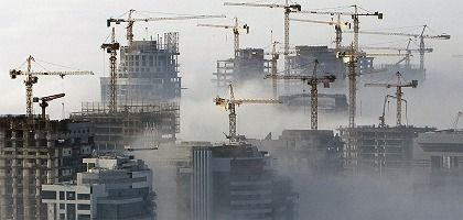 Fog rolls in to a construction site in Dubai. The Arab world is eager to find out what the Obama administration holds for it.