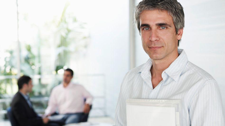 Manager-Symbolbild: Große Einkommensunterschiede zwischen den Branchen