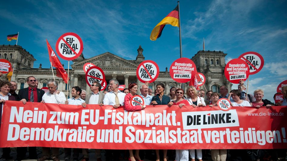Members of Germany's Left Party protest against the EU fiscal pact before a planned vote to ratify the treaty in parliament on Friday.