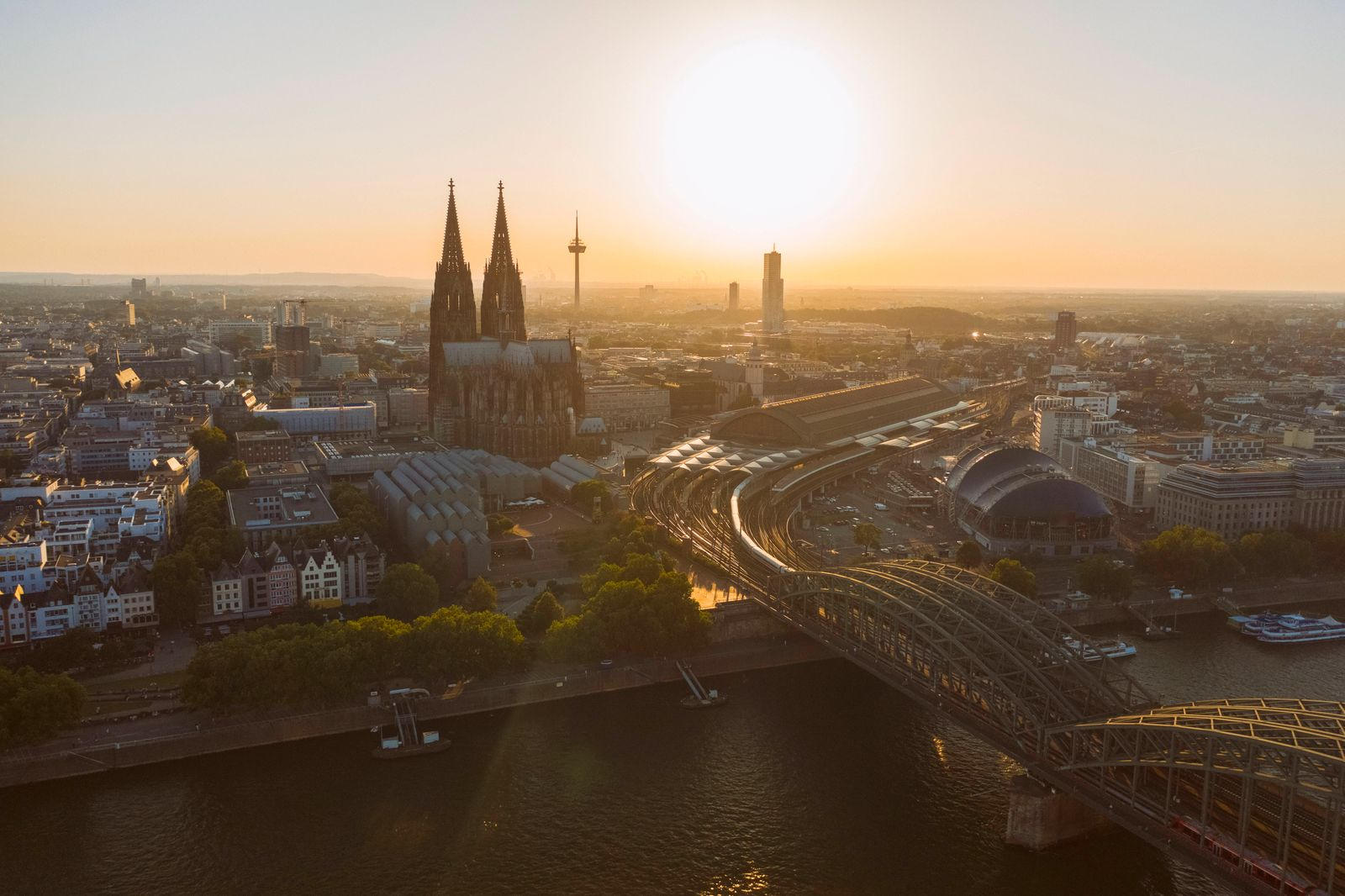 Germany, Cologne, Rhine River, View of river and city at sunset TAMF02800