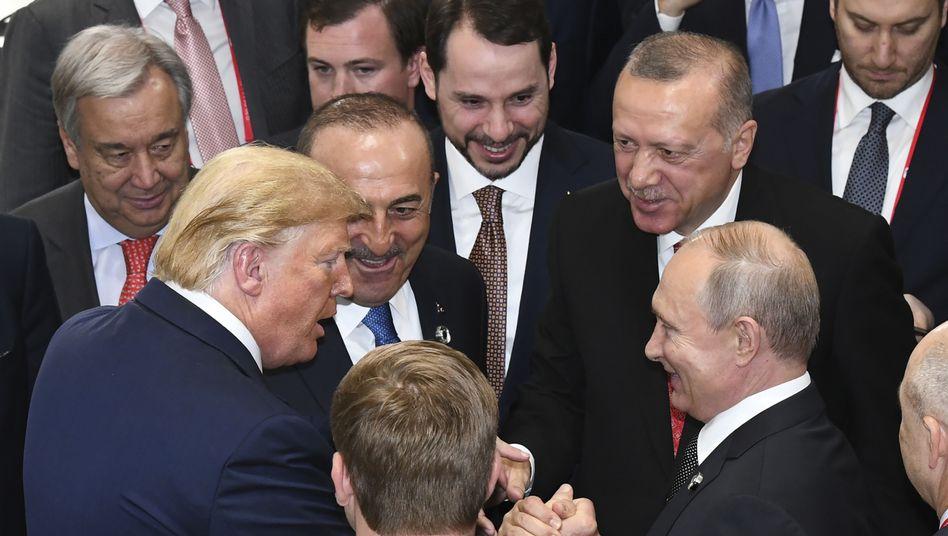 Donald Trump, Recep Tayyip Erdoğan und Wladimir Putin (v.l.)