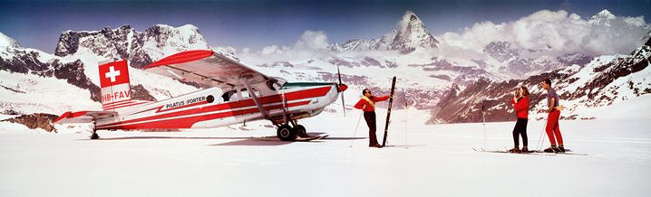 Skiers and airplane 1964 by Neil Montanus