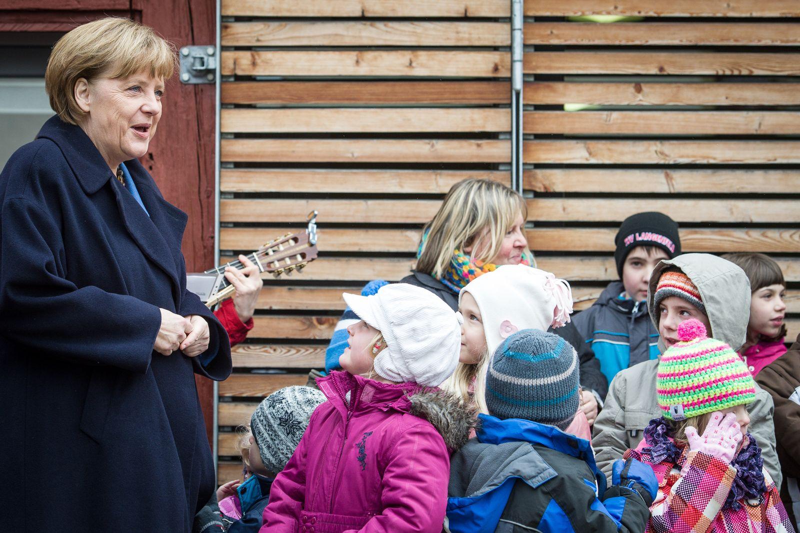 Merkel mit Kindern