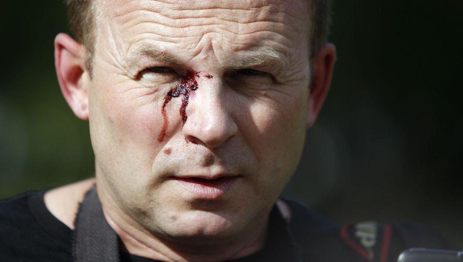 AP-Fotograf Sergei Grits: Geschlagen und abgeführt