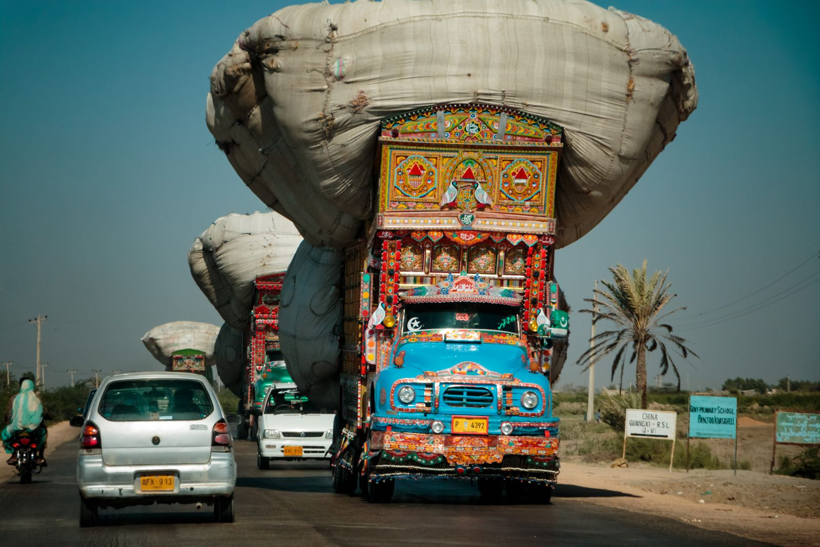 Overloaded painted truck on the road, On the N5, Sindh, Pakistan